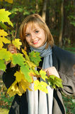 Woman In Autumn Park Near Maple Royalty Free Stock Photography