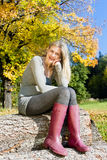 Woman In Autumnal Nature Royalty Free Stock Photography