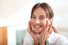 Woman In Bathroom In The Morning Stock Photography