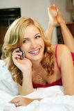 Woman In Bed At Home Stock Images