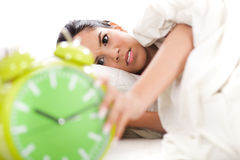 Woman In Bed With Alarm Clock Royalty Free Stock Photos