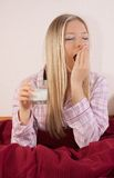 Woman In Bed With Glass Of Milk Stock Photos