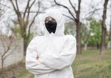 Free Woman In Black Mask And Protective Suit Stock Images - 179407154