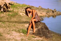 Free Woman In Brown And Black Leopard Cami Dress Siting On Grey Rock During Daytime Stock Photos - 82931293