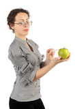 Woman In Business Dress Holding An Apple Royalty Free Stock Photo