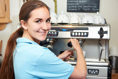 Woman In Cafe Making Cup Of Coffee Royalty Free Stock Images