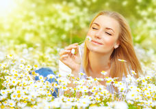 Woman In Chamomile Field Stock Image