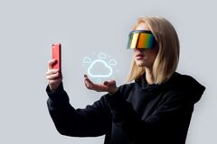Free Woman In Concept VR Glasses Using Cloud Storage On Mobile Phone On White Background Stock Photography - 174475702