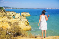Free Woman In Dress Alone With Beautiful Coastline Of The Rocky Beach, Lagos, Portugal Stock Images - 81074254