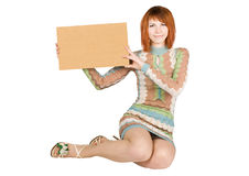 Woman In Dress Sitting And Holding Cardboard Royalty Free Stock Photos