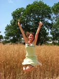 Woman In Field Jump Stock Photography