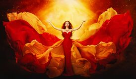 Woman In Flying Dress Raised Arms To Mystery Light, Girl In Red Gown Stock Photography