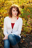 Woman In Front Of Autumn Trees Royalty Free Stock Photo