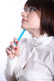 Woman In Glasses With Blue Pen Royalty Free Stock Image