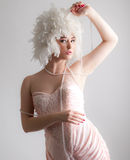 Woman In Gorgeous Wig Playing With Pearls Royalty Free Stock Images