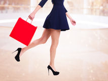 Woman In High Heels With Red Shopping Bag. Royalty Free Stock Image
