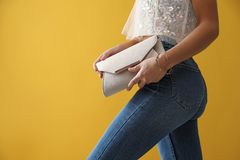 Free Woman In Jeans With Clutch Purse On Background, Closeup Royalty Free Stock Photo - 166398175