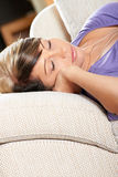 Woman In Living Room Is Sleeping Stock Images