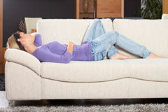 Woman In Living Room Is Smiling Royalty Free Stock Photo