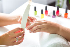 Free Woman In Nail Salon Receiving Manicure Royalty Free Stock Images - 29150849