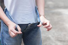 Free Woman In Oversize Jeans Showing How Much Weight Lost. Diet Fat Weight Loss Healthy Lifestyles Concept. Stock Images - 161743924