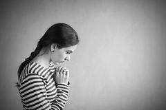 Woman In Profile Praying Stock Image