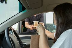 Free Woman In Protective Mask Taking Coffee At Drive Thru During Covid-19 Outbreak. Stock Photography - 178536592