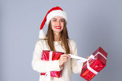 Woman In Red Christmas Hat Holding Presents Royalty Free Stock Image