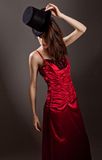 Woman In Red Dress And Top Hat Royalty Free Stock Photo