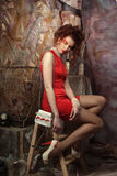 Woman In Red Dress With White Handbag Stock Photo