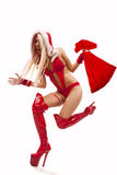 Woman In Santa Claus Suit With Gift Bag Royalty Free Stock Images