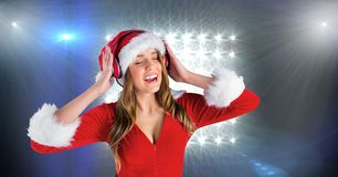 Free Woman In Santa Costume Listening To Music On Headphones Royalty Free Stock Photography - 92881737