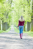 Woman In Spring Alley Royalty Free Stock Photos