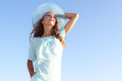 Woman In Summer Hat Over Sky Background Royalty Free Stock Photo