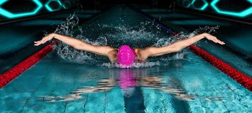Woman In Swimming Pool. Butterfly Swimming Style Stock Photography