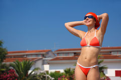Woman In Swimsuit Stands On Beach Royalty Free Stock Images