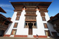 Woman In Traditional Bhutanese Dress Walking In Paro Rinpung Dzong, Buddhist Monastery And Fortress On A Hill Near The Paro Chu R Stock Photos