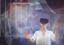 Free Woman In VR Headset Touching Interface Against Galaxy City Background Stock Photo - 94947730