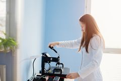 Woman In White Lab Thermal Transferring Image Royalty Free Stock Photography