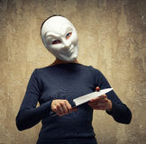 Woman In White Mask Holding The Knife Stock Photos
