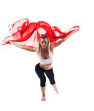Woman In Yoga Pose And Yellow Flying Fabric