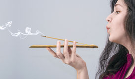 Woman with incense stick Royalty Free Stock Photos