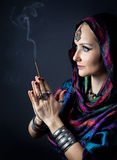 Woman with incense Stock Photo