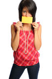 Woman with index card. Attractive hispanic woman holding bright index cards on a white background Stock Image