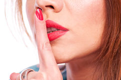 Woman showing shush Royalty Free Stock Image