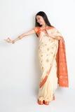 Woman in Indian sari dress dancing Stock Images
