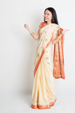 Woman in Indian sari dress thumbs up Royalty Free Stock Images