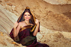 Woman in indian sari with a kerchief on her head Royalty Free Stock Photo