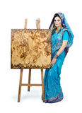 Woman in Indian turquoise sari with pyrography painting Royalty Free Stock Image