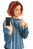 Woman indicate to phone mobile Royalty Free Stock Images